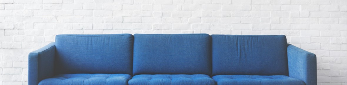 A blue couch like one would find in an office